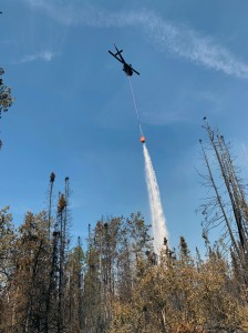 A helicopter drops water on an active part of the Montana Creek Fire on Friday, July 5, 2019. Photo by Josh Turnbow/UAF Nanooks Wildland Fire Crew