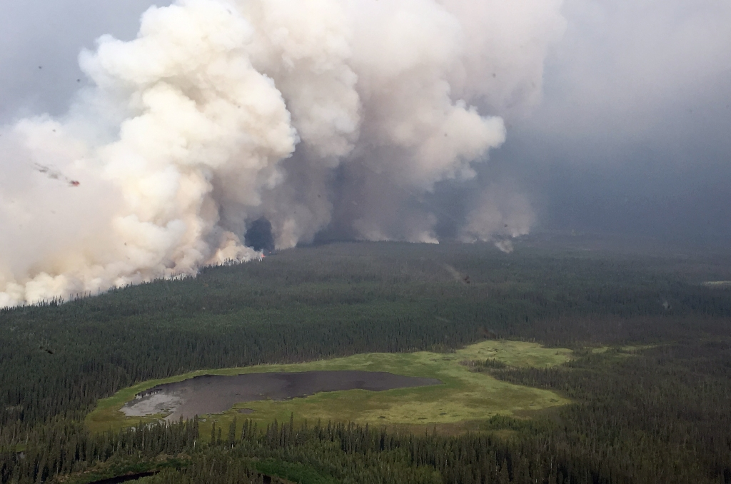 Smoke rolls off the Bearnose Hill Fire (#407) along its northwestern flank Sunday afternoon, July 14, 2019. The Bearnose Hill Fire is one of four fires that make up the Chalkyitsik Complex located about 50 miles east of Fort Yukon. Karen Scholl/Alaska Interagency Incident Management Team