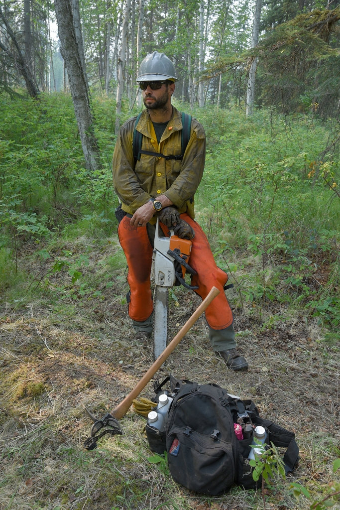 Grangeville, Idaho, Smokejumper Lee Trap takes a break from saw work as he and three other smokejumpers work on site protection along the Little Black River on Wednesday, July 17, 2019. Sam Harrel/Alaska Interagency Incident Management Team