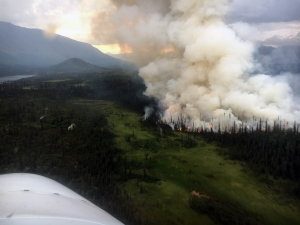 A smoke plume from the Rainy Pass Fire (#664) as seen at around 9 p.m. Tuesday, July 23, 2019. Phot oby Alaska Division of Forestry Air Attack
