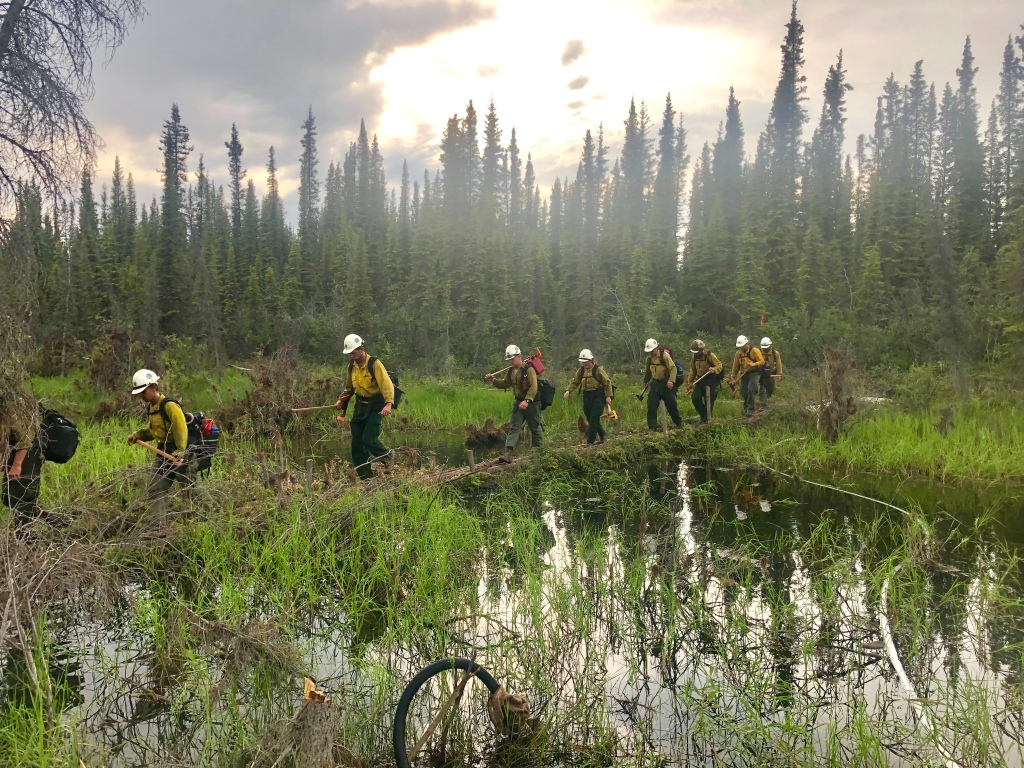 Members of the Union Hotshots from La Grande, Oregon, make a water crossing while fighting the Chandalar River Fire near Venetie, Alaska. CREDIT: Union Hotshots