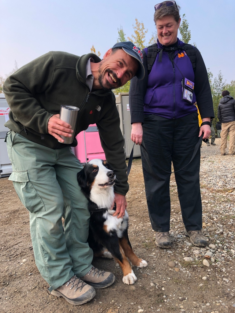 Former Smokejumper and Public Information Officer Jacob Welsh enjoys a visit with Puck following the morning briefing for the McKinley Fire. Photo: Kale Casey/Alaska IMT