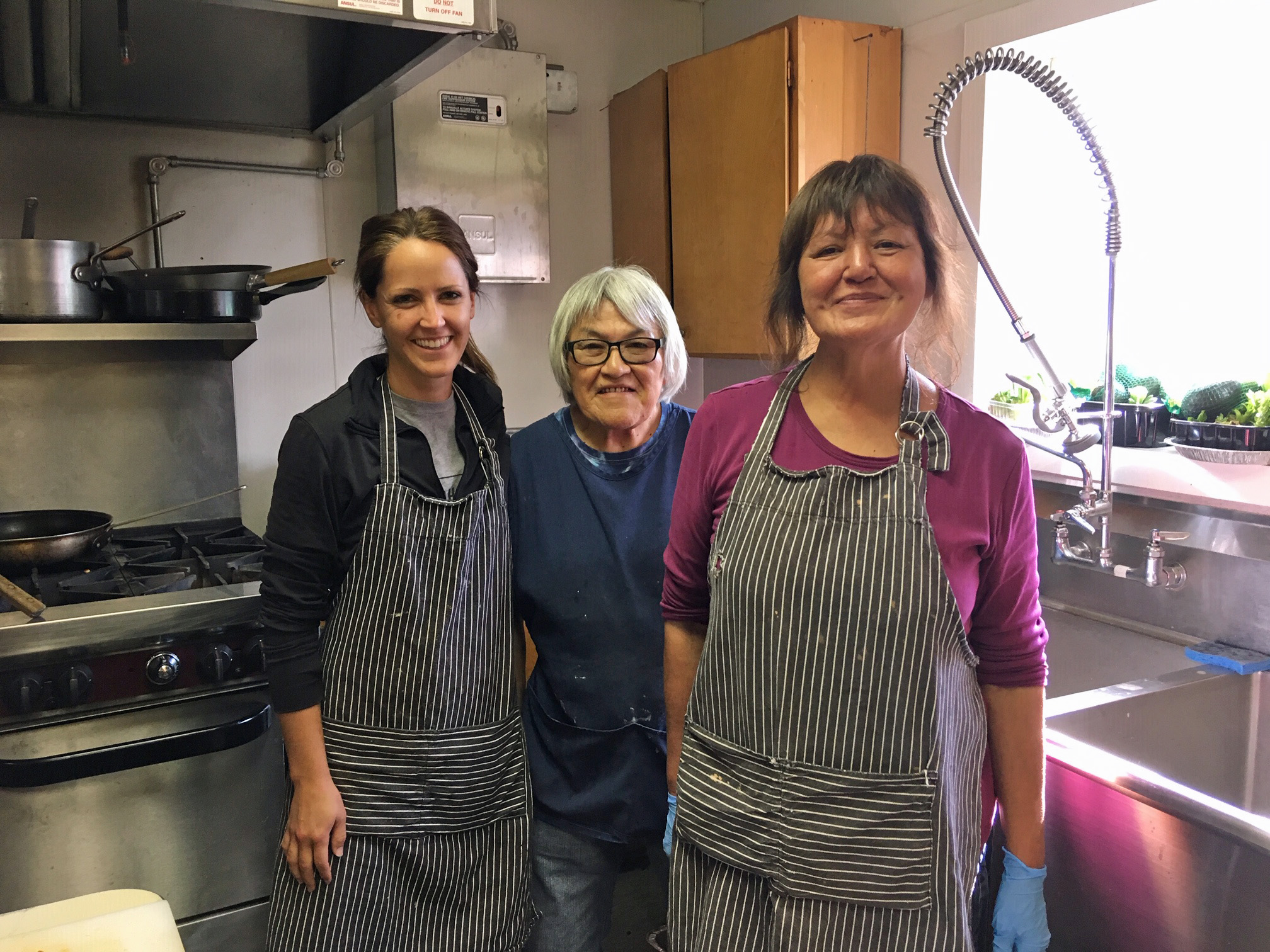 Three women at the Fort Yukon fire station kitchen.