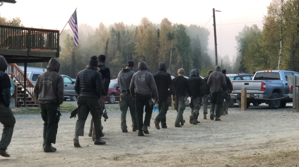 Pioneer Peak Hotshot crew members head to the McKinley Fire line in the early morning hours