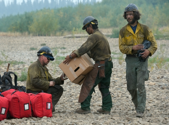 Members of the Tanana Chiefs Crew organize their packs and equipment on a Draanjik River gravel bar Saturday, July 27, 2019, as they move to another work area on the Chalkyitsik Complex. Sam Harrel/Alaska Interagency Incident Management Team