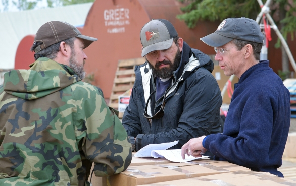 BLM Alaska Fire Service Manager Kent Slaughter, right, talks with Chalkyitsik Ramp Manager Jarrod Bohrman, middle, and a Bearing Air pilot Friday, Aug. 2, 2019, at the Chalkyitsik Airport. Slaughter had spent time with the BLM North Star Type 2 hand crew.  Sam Harrel/ Alaska Incident Management Team