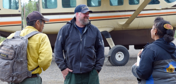 Incident Commander Norm McDonald, middle, visits with Strike Team Crew Boss Neil Charlie, left, and Receiving and Distribution Manager Cheryl Ballot after he arrived at the Chalkyitsik Airport on Friday, Aug. 2, 2019. McDonald was visiting the Forward Operating Base of the Chalkyitsik Complex in Chalkyitsik, Alaska. Sam Harrel/ Alaska Incident Management Team