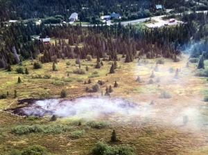 This photo of the South Fork Fire taken Monday morning by Mat-Su Area Forestry helitack crew member Colton Stegner shows the proximity of the fire to residences in the area. Photo by Colton Stegner/Alaska Division of Forestry.
