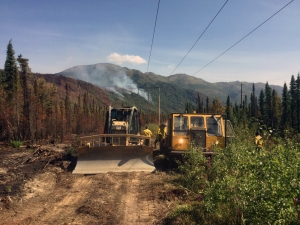 Personnel working on the Swan Lake Fire use a hydro seeder to reseed a section of dozer line on Monday, August 13, 2019. Photo by Alaska Division of Forestry