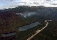 Smoke from the east side of the Swan Lake Fire rises above Upper Jean Lake along the Sterling Highway on Thursday, August 16, 2019. Photo by Brentwood Reid/Alaska Division of Forestry