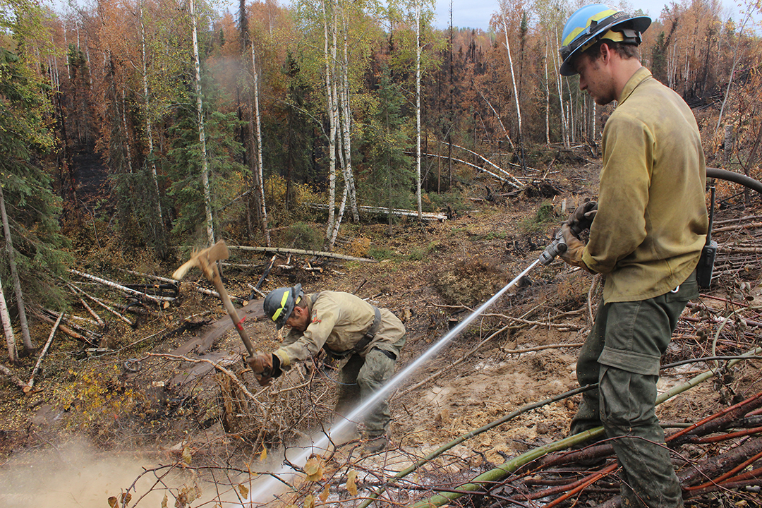 "Engine Crewmembers from ""Forrest Fire"" Type 4 Engine Dean Seibold (left) and Brian Van Dusen Dig and Spray Hot Spots and Ash Pits Near the Parks Highway. Photo credit Mike McMillian"