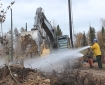 Extinguishing hot spots with heavy equipment and water. Photo Mike McMillan