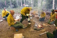 Photo of From left to right, firefighters Lakota Burwell, Troy Coberly, Charlie Pohlman, Sarah Nelson and Brian Pitts cook diner over a fire while on the Zitziana River Fire in June of 2018. Photo by Beth Ipsen, BLM AFS public affairs specialist