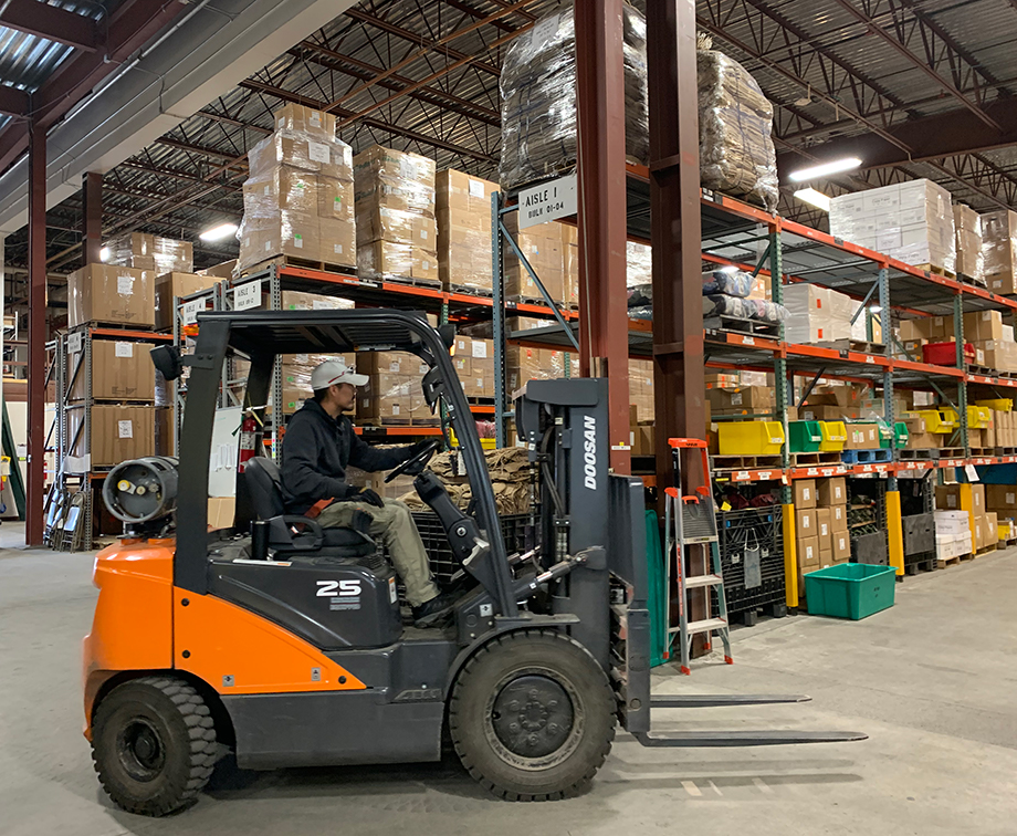 Warehouse worker Jerry Nollner drives a forklift in the BLM AFS Cache on Sept. 24, 2019.