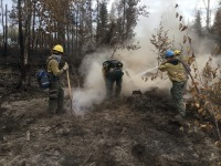 Firefighters mop up in deep ash on the McKinley Fire - Photo credit : Bruce Giersdorf