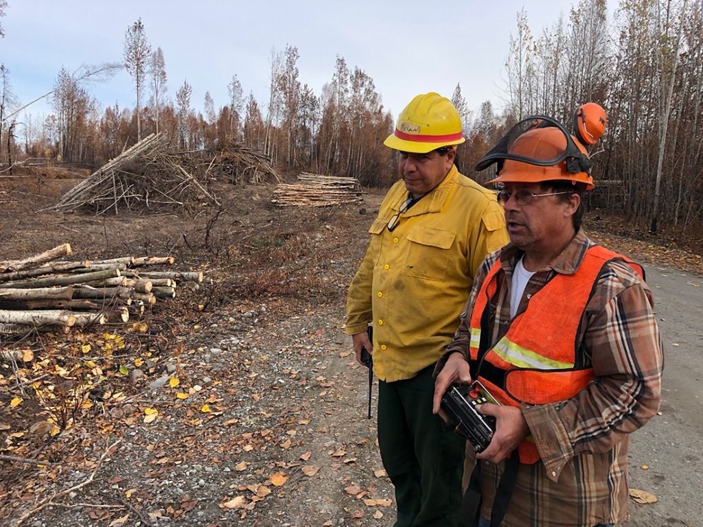 Operator and Division Supervisor oversee massive chipping operations along the Mat-Su Borough right of way. Photo credit: PIO Kale Casey/Alaska IMT/Alaska DNR
