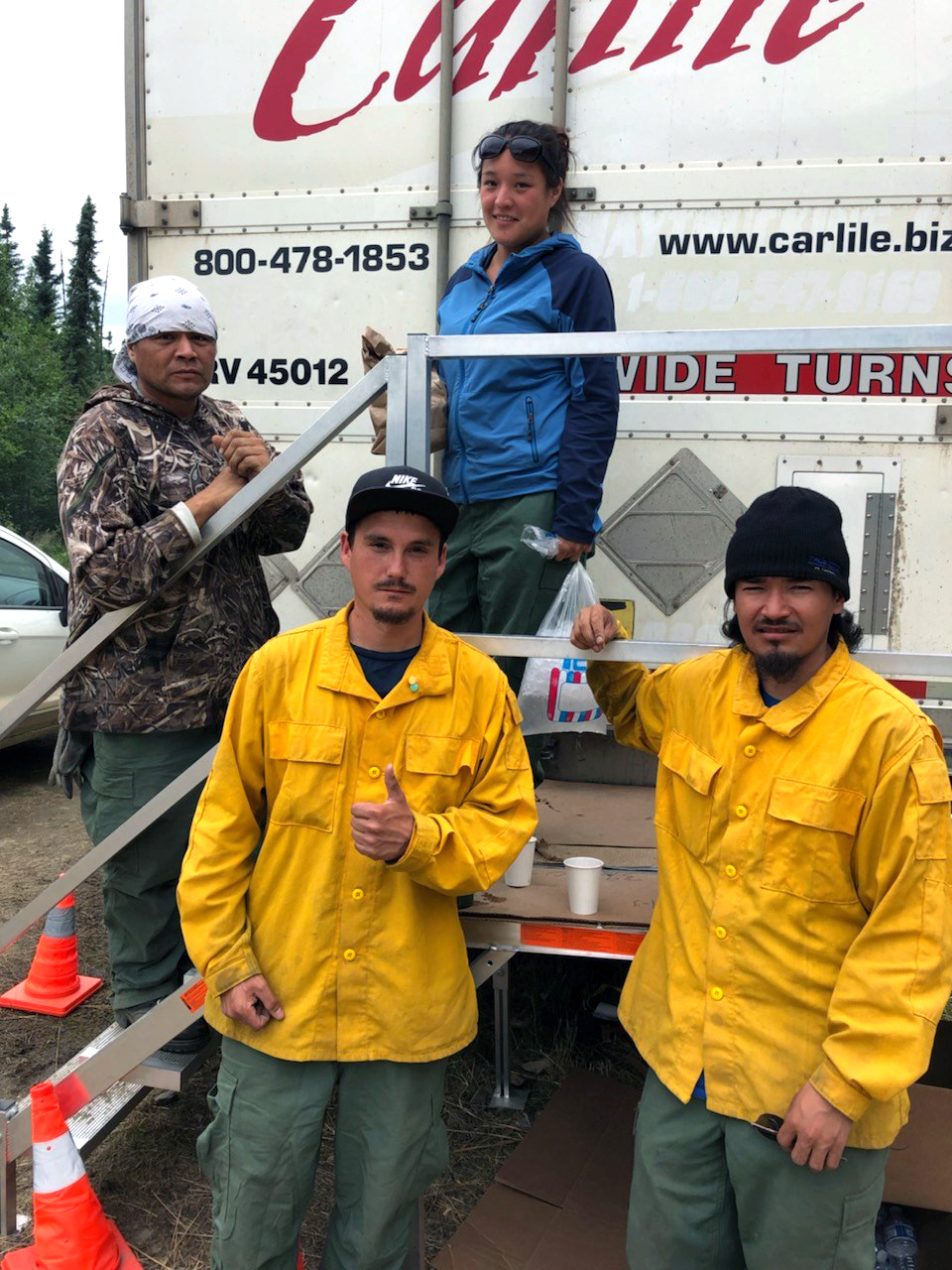 Photo of four camp crew members working on the Shovel Creek Fire near Fairbanks.