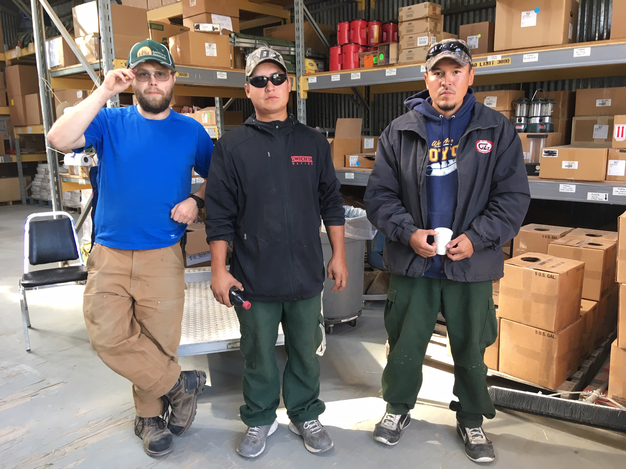 Photo of three workers at the Fort Yukon fire station warehouse.
