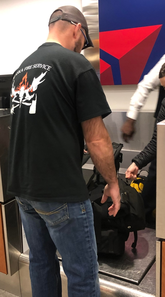 Man checks in bags at the airport.