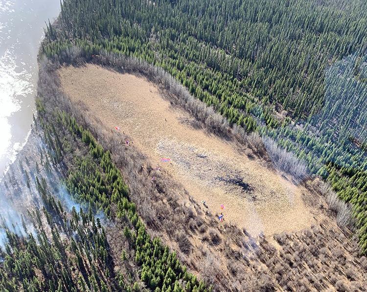 Photo of fire on landscape.