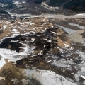 This photo shows the area blackened by a suspected coal seam fire off Healy Spur Road near Healy on Thursday night. The fire was extinguished with water drops from a helicopter and will be monitored by the Fairbanks Forestry station. Patches of snow surround the blackened area.