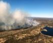 Smoke from a wildfire burning in tundra grass near Pilot Point, Alaska