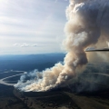 A smoke column rises from the About Mountain Fire (#193) along the east bank of the Kuskokwim River on Monday night, June 14, 2021