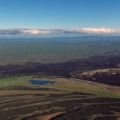 The blackened burn scar of the 2,066-acre About Mountain Fire approximately 6 miles south of McGrath is visible in this aerial photo taken Thursday, June 18, 2021. Fire behavior was significantly reduced with rain on Thursday. Matt Snyder/Alaska DNR-Division of Forestry