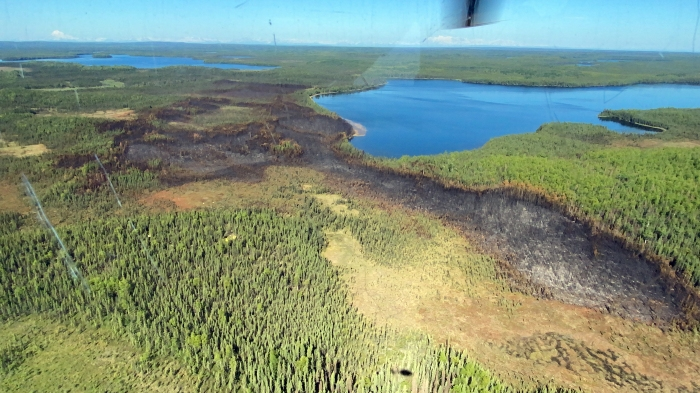 An aerial photo of the Loon Lake Fire scare with Swan Lake in the background