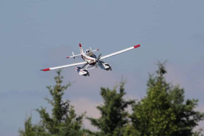 A Fire Boss water-scooping plane approaches Chena Lakes to dip another load of water during initial attack of the Brock Road Fire on Sunday, June 27, 2021.