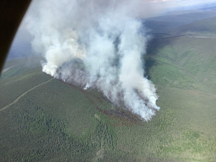 Smoke rises from the Haystack Fire north of Fairbanks. Red retardant lines are visible on the left side of the fire.