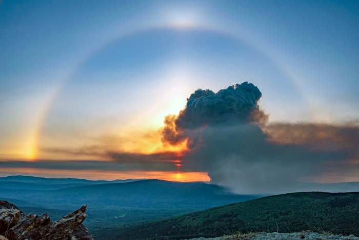 A sun dog over the smoke plume from the Haystack Fire burning about 20 miles north of Fairbanks at approximately 11:30 p.m. Tuesday, June 16, 2021. Photo by Crystal Glassburn