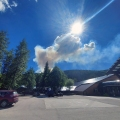 A smoke column from the Munson Creek Fire as seen from the parking lot at Chena Hot Springs Resort