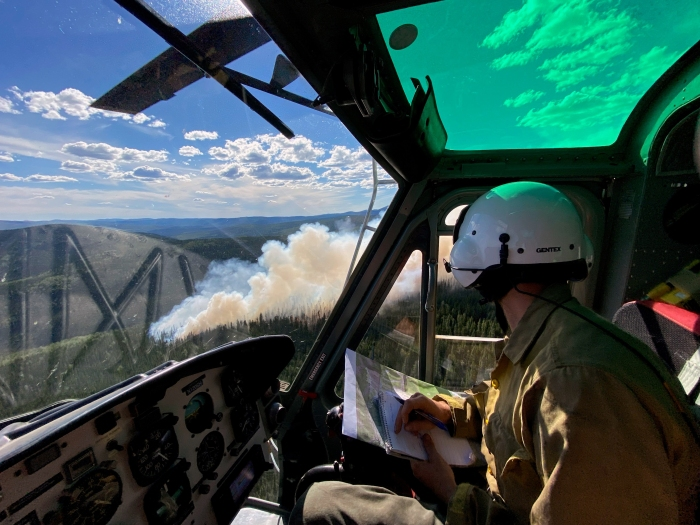 Someone sitting in a helicopter looking at smoke out the window form the Munson Creek Fire.