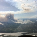 The Dry Creek Fire (#195) on the right and the Zitziana River Fire(#197) are burning south of the Tanana River, pictured at the bottom, about 7 miles from Manley Hot Springs. Photo taken by Brett Fairchild on June 15, 2021.