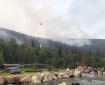 A helicopter drops water on the Munson Creek Fire burning directly behind Chena Hot Springs Resort on Tuesday, July 6, 2021. Ira Hardy/Alaska DNR-Division of Forestry.