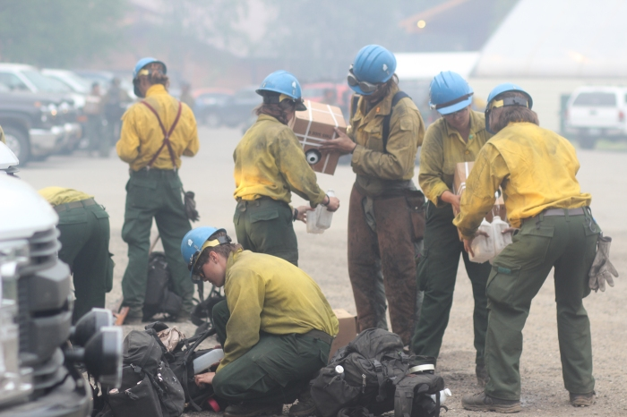 UAF Nanooks Fire Crewmembers refill water bottles after shift Monday, July 5, 2021 at the Munson Creek Fire burning behind Chena Hot Springs. Mike McMillan/Alaska DNR-Division of Forestry