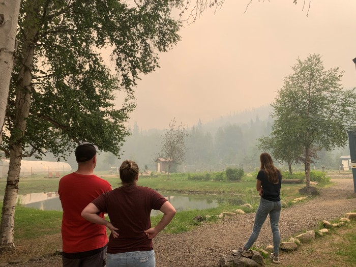 Guests at Chena Hot Springs Resort watch the Munson Creek Fire behind Chena Hot Springs on Monday, July 5, 2021. Ira Hardy/Alaska DNR-Division of Forestry