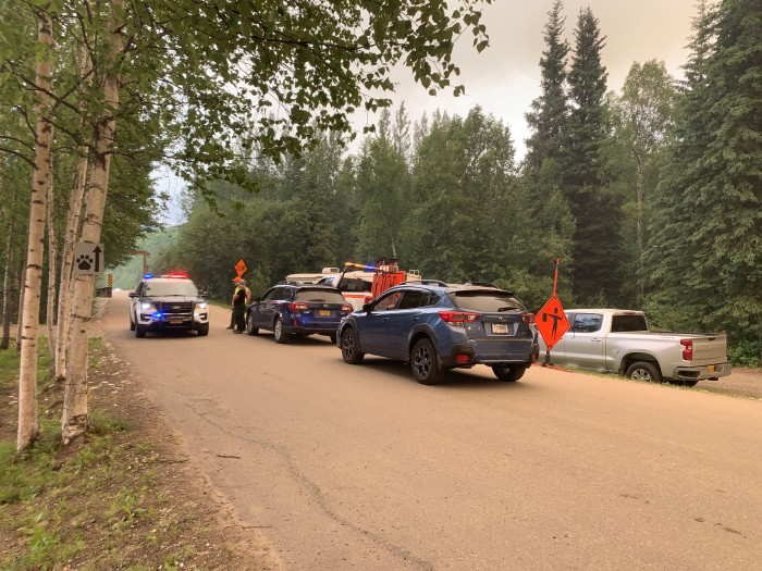 Alaska State Troopers assist with evacuation efforts at Chena Hot Springs during the Munson Creek Fire on Monday, July 5, 2021. Troopers went door to door at each cabin along Chena Hot Springs Road between mile 48-56 to ensure residents knew of the evacuation order issued. Ira Hardy/Alaska DNR-Division of Forestry