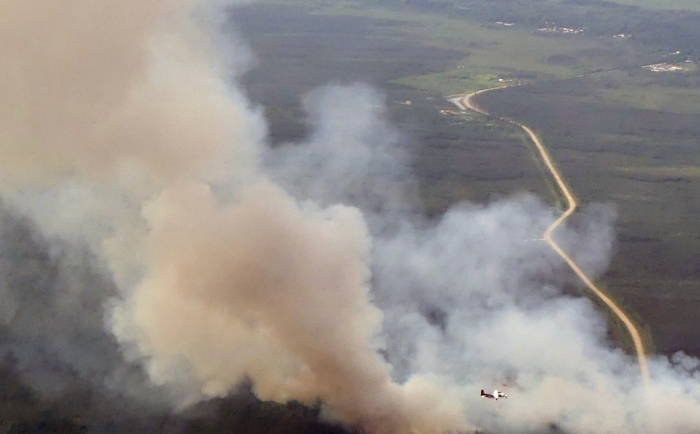 A smokejumper airplane circles the Deadwood Fire burning south of Central at about 5 p.m. on July 2, 2021.