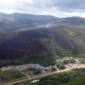 Smoke from the Muson Creek Fire rises off the ridge above Chena Hot Springs Resort on Thursday, July 8, 2021, as seen in this photo from an aerial reconnaissance flight. Sam Harrel/Alaska DNR-Division of Forestry