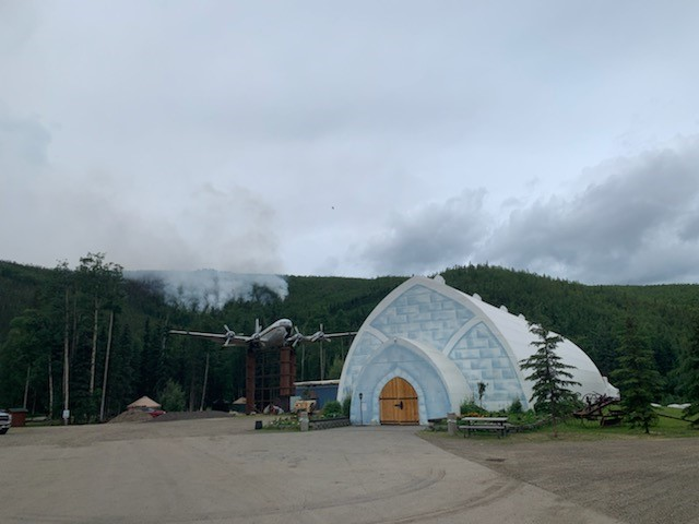 Smoke from the Munson Creek Fire is visible on the hillside behind the Aurora Ice Museum at Chena Hot Springs Resort on Tuesday, July 6, 2021.