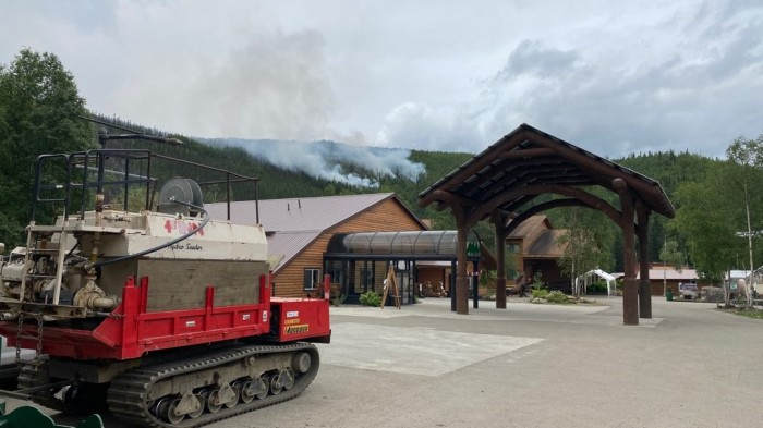 Smoke from the Munson Creek Fire burning behind Chena Hot Springs Resort is visible as fingers of the fire creep down the hillside behind the resort on Tuesday morning, July 6, 2021. Sam Harrel/Alaska DNR-Division of Forestry