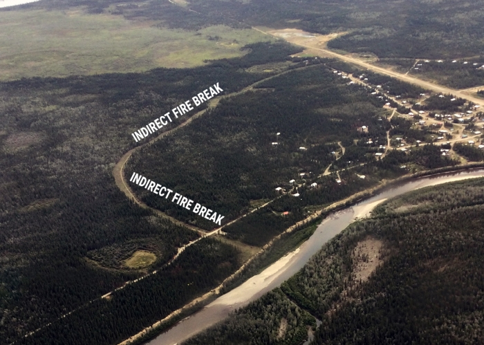 A fire break constructed around part of the village of Venetie as seen from the air.