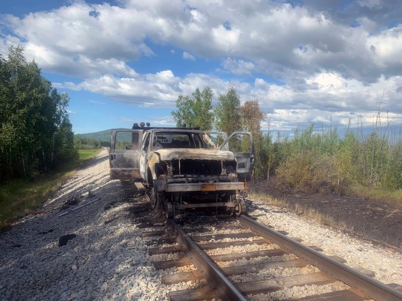 A burned-up Alaska Railroad truck on the railroad tracks outside Nenana.