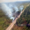 Smoke from a fire along the Alaska Railroad tracks outside of Nenana.