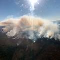 Blob of smoke drifting up from ground.