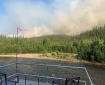 Smoke rises from a wildfire across the Chena River